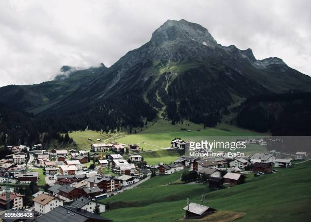 scenic view of houses and mountains against sky - lech stock photos and pictures