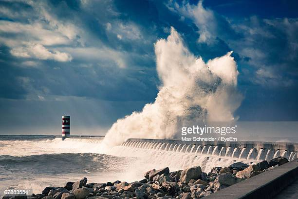 Scenic View Of Huge Wave Crashing Against Breakwater
