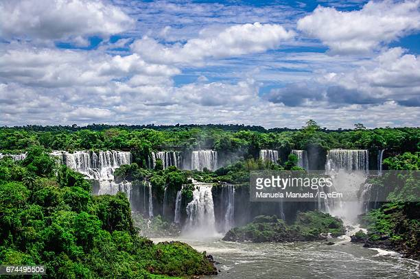 Scenic View Of Iguazu Falls Against Cloudy Sky