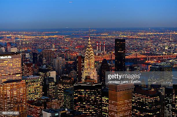 Scenic View Of Illuminated Cityscape Against Blue Sky