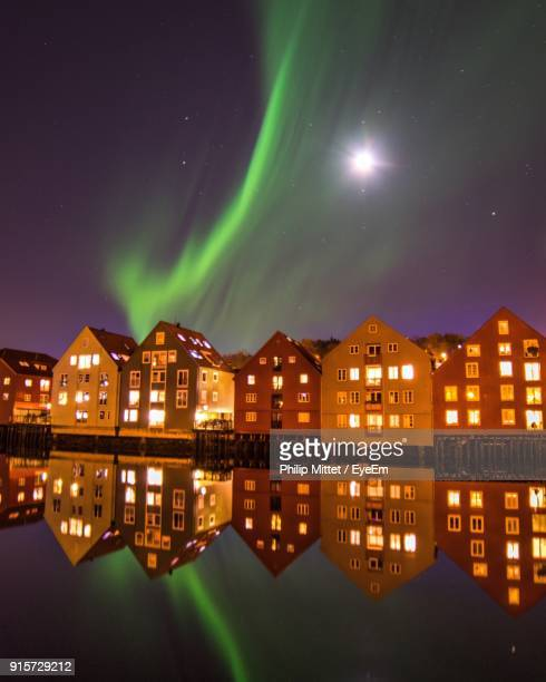 scenic view of illuminated houses against sky at night - trondheim fotografías e imágenes de stock