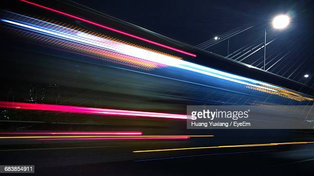 scenic view of illuminated street at night - light trail stock pictures, royalty-free photos & images
