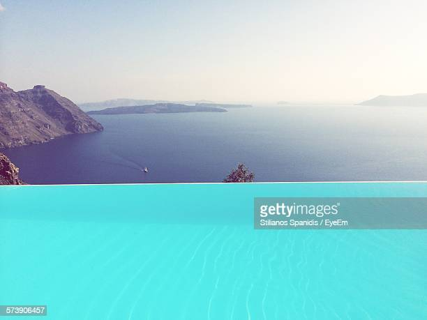 Scenic View Of Infinity Pool By Sea At Santorini