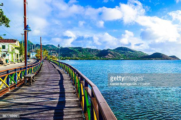 Scenic View Of Jetty Against Cloudy Sky