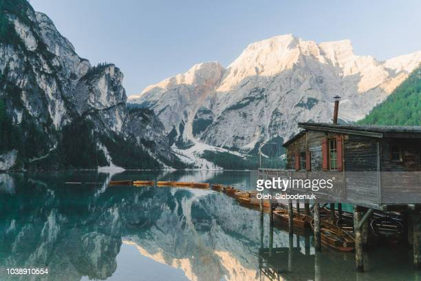 scenic view of lago di braies  in dolomites - shack stock pictures, royalty-free photos & images