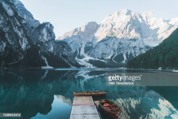 scenic view of lago di braies  in dolomites - european alps stock photos and pictures