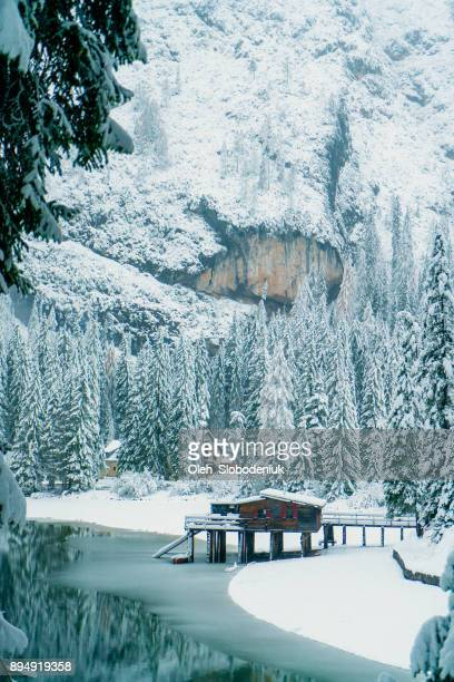 scenic view of lago di braies lake in winter - pragser wildsee stock pictures, royalty-free photos & images