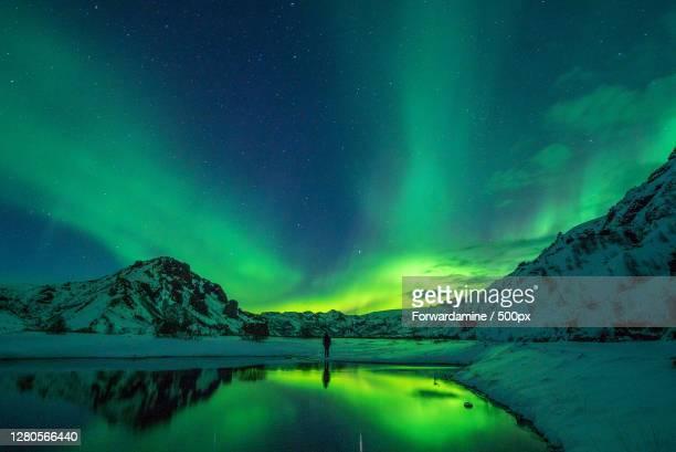 scenic view of lake against aurora borealis at night,norway - de ruimte en astronomie stockfoto's en -beelden