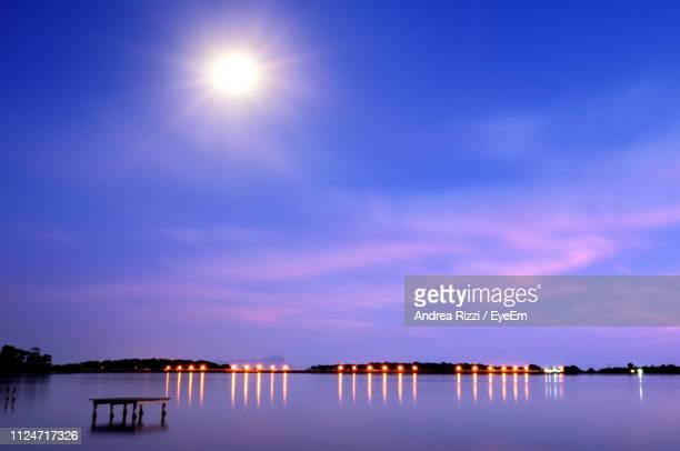 scenic view of lake against blue sky - andrea rizzi stock pictures, royalty-free photos & images