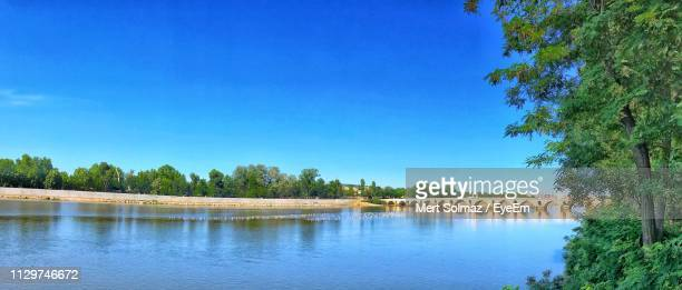 scenic view of lake against blue sky - edirne stock pictures, royalty-free photos & images