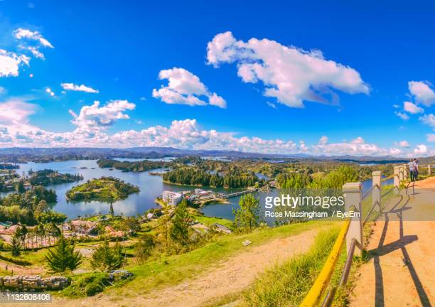 scenic view of lake against blue sky - guatapé stock pictures, royalty-free photos & images
