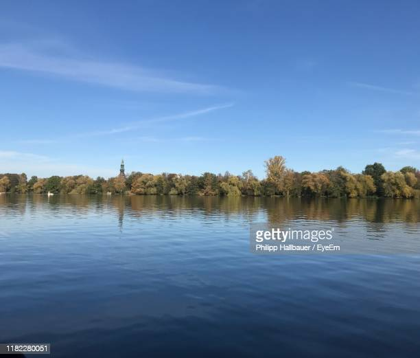 scenic view of lake against blue sky - zwickau stock pictures, royalty-free photos & images