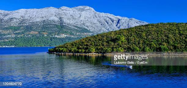 scenic view of lake against blue sky - ljubomir belic stock pictures, royalty-free photos & images