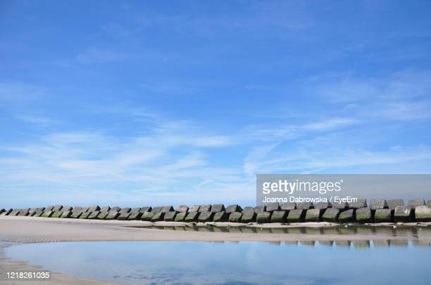 scenic view of lake against blue sky - 防波堤 ストックフォトと画像