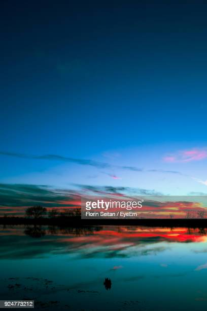 scenic view of lake against blue sky - florin seitan stock pictures, royalty-free photos & images