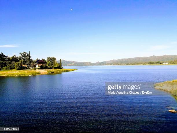 scenic view of lake against blue sky - cordoba argentina stock photos and pictures