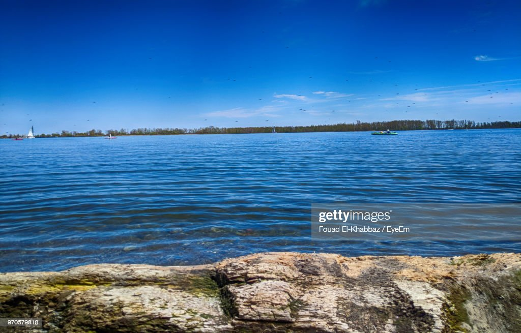 Scenic View Of Lake Against Blue Sky : Stock Photo