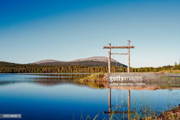 scenic view of lake against clear blue sky - heinovirta stock photos and pictures