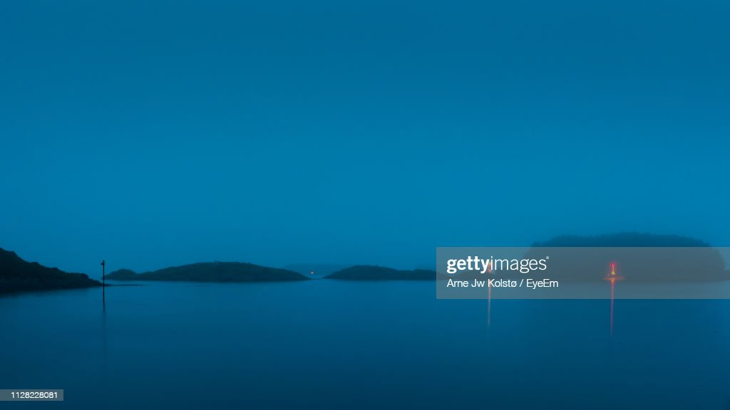 Scenic View Of Lake Against Clear Blue Sky : Stock Photo