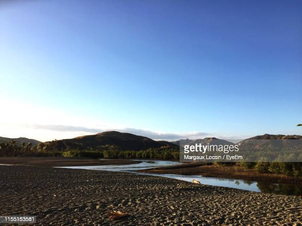 scenic view of lake against clear blue sky - margaux stockfoto's en -beelden
