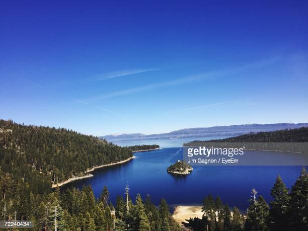 scenic view of lake against clear blue sky - サウスレイクタホ ストックフォトと画像