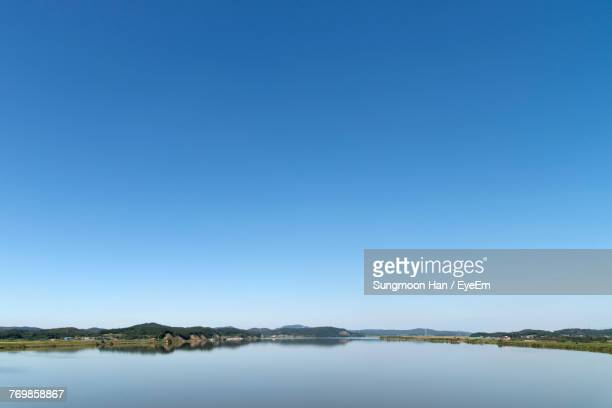 scenic view of lake against clear blue sky - clear sky stock pictures, royalty-free photos & images