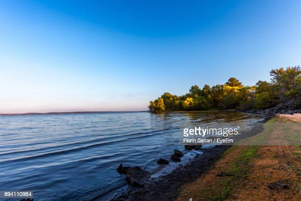 scenic view of lake against clear blue sky - florin seitan stock pictures, royalty-free photos & images