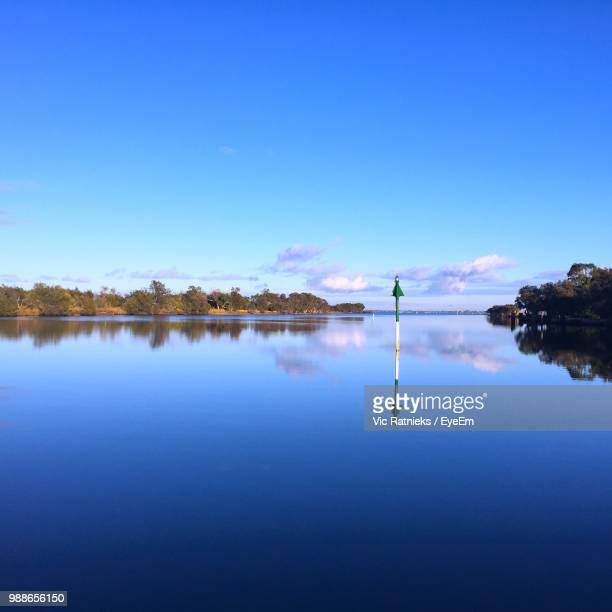 scenic view of lake against clear blue sky - ratnieks stock pictures, royalty-free photos & images