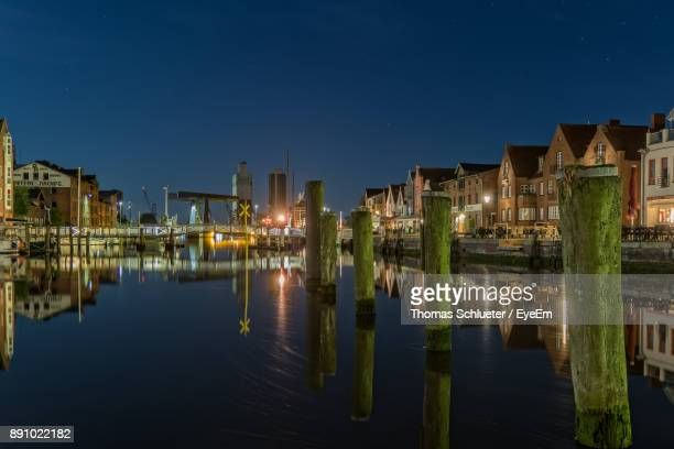 scenic view of lake against clear sky at night - husum stock-fotos und bilder