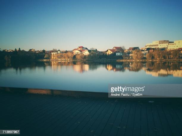 Scenic View Of Lake Against Clear Sky At Sunset