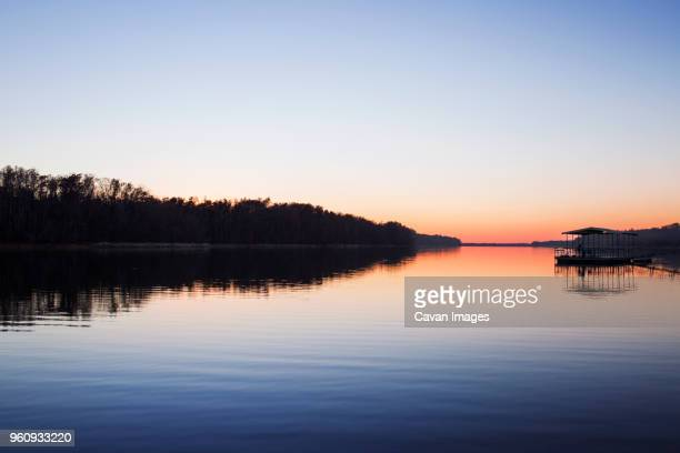 scenic view of lake against clear sky at sunset - スプリングフィールド ストックフォトと画像