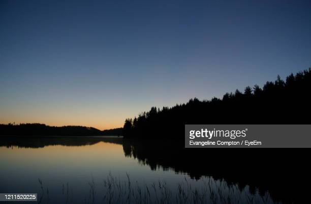 scenic view of lake against clear sky during sunset - forrest compton stock pictures, royalty-free photos & images