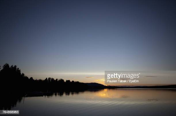 scenic view of lake against clear sky during sunset - paulien tabak stock pictures, royalty-free photos & images