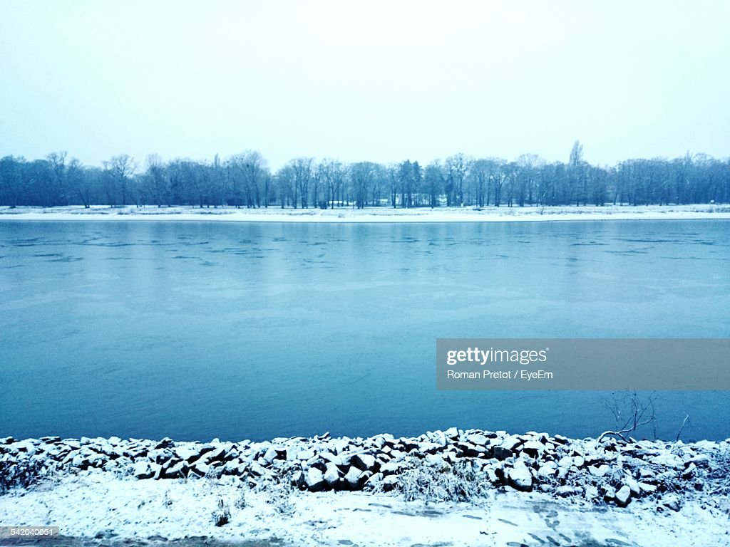 Scenic View Of Lake Against Clear Sky During Winter : Photo
