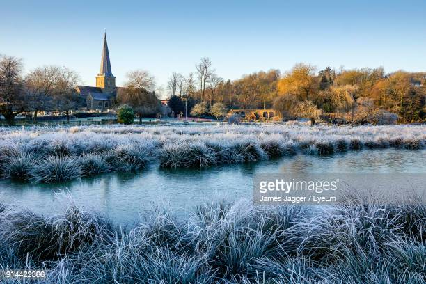 scenic view of lake against clear sky during winter - surrey england stock photos and pictures