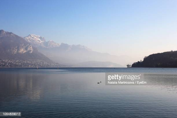 scenic view of lake against clear sky - annecy fotografías e imágenes de stock