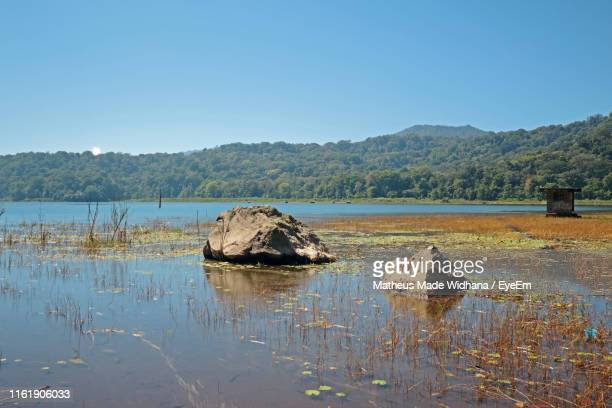 scenic view of lake against clear sky - made widhana stock photos and pictures