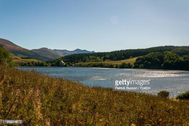 scenic view of lake against clear sky - auvergne rhône alpes stock pictures, royalty-free photos & images