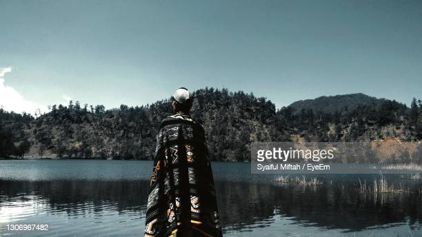 scenic view of lake against clear sky - k2 mountain stock pictures, royalty-free photos & images