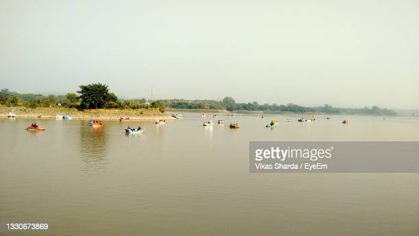 scenic view of lake against clear sky - chandigarh stock pictures, royalty-free photos & images