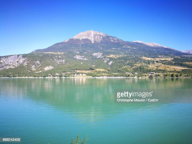 scenic view of lake against clear sky - embrun stock photos and pictures
