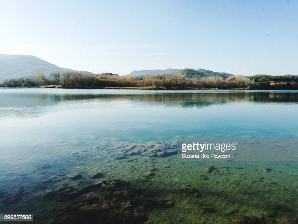 scenic view of lake against clear sky - banyoles stock pictures, royalty-free photos & images