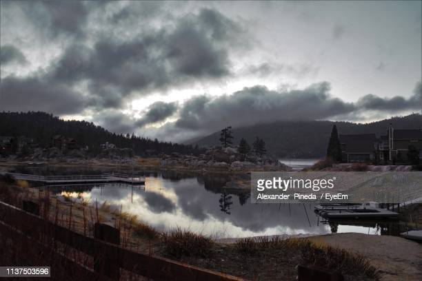 scenic view of lake against cloudy sky during sunset - big bear lake stock pictures, royalty-free photos & images