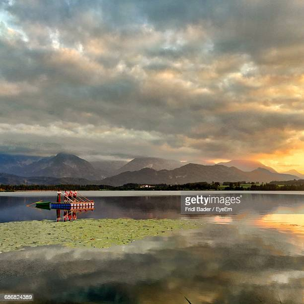 Scenic View Of Lake Against Cloudy Sky During Sunset