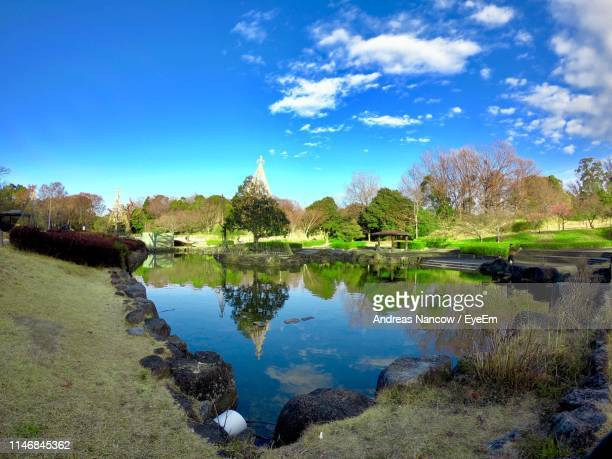 scenic view of lake against cloudy sky - nagoya stock pictures, royalty-free photos & images