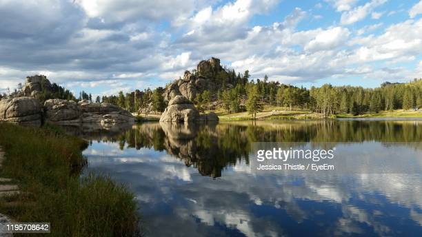 scenic view of lake against cloudy sky - black hills stock pictures, royalty-free photos & images