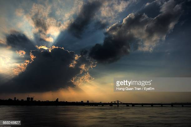 scenic view of lake against cloudy sky - hong quan stock pictures, royalty-free photos & images