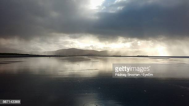 scenic view of lake against cloudy sky - brosnan stock photos and pictures