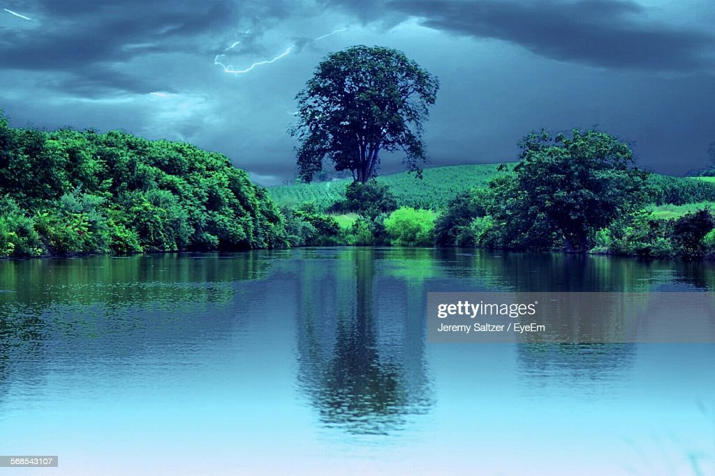 Scenic View Of Lake Against Cloudy Sky : Stock Photo
