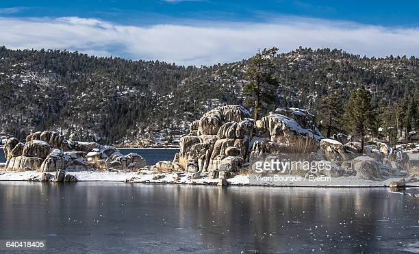 scenic view of lake against cloudy sky - big bear lake stock photos and pictures